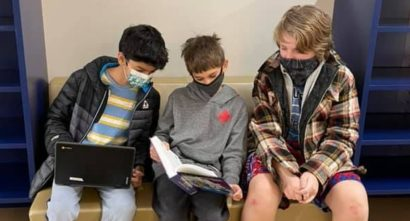 Colorado SKIES Academy learners reading together